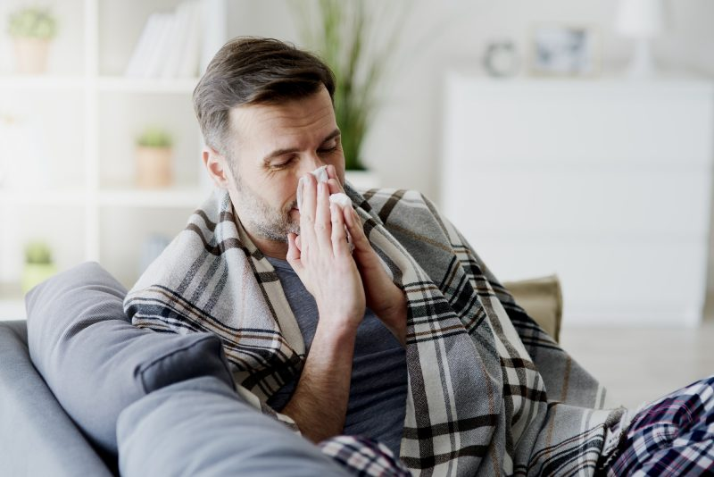 Man with flu staying at home